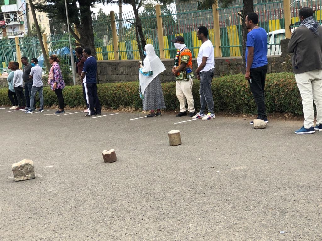 Observing social distancing outside a supermarket in Addis Ababa, 15 April 2020.